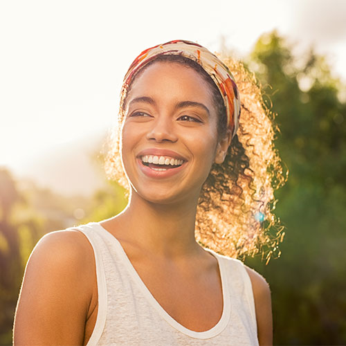 young woman with nice teeth outside