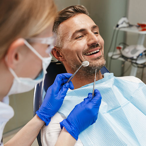 middle aged man in dentists chair